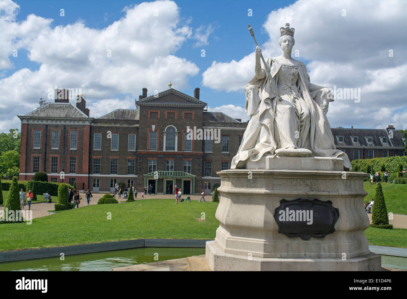 Statue of Queen Victoria outside of Kensington Palace a royal residence set in Kensington Gardens London England Stock Photo
