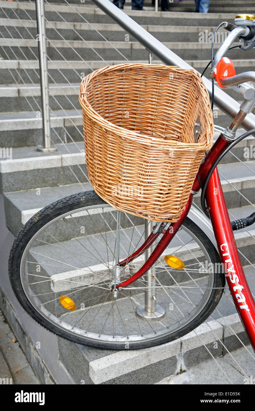 Bicycle With A Wicker Basket Secured To Stair Railings In ...