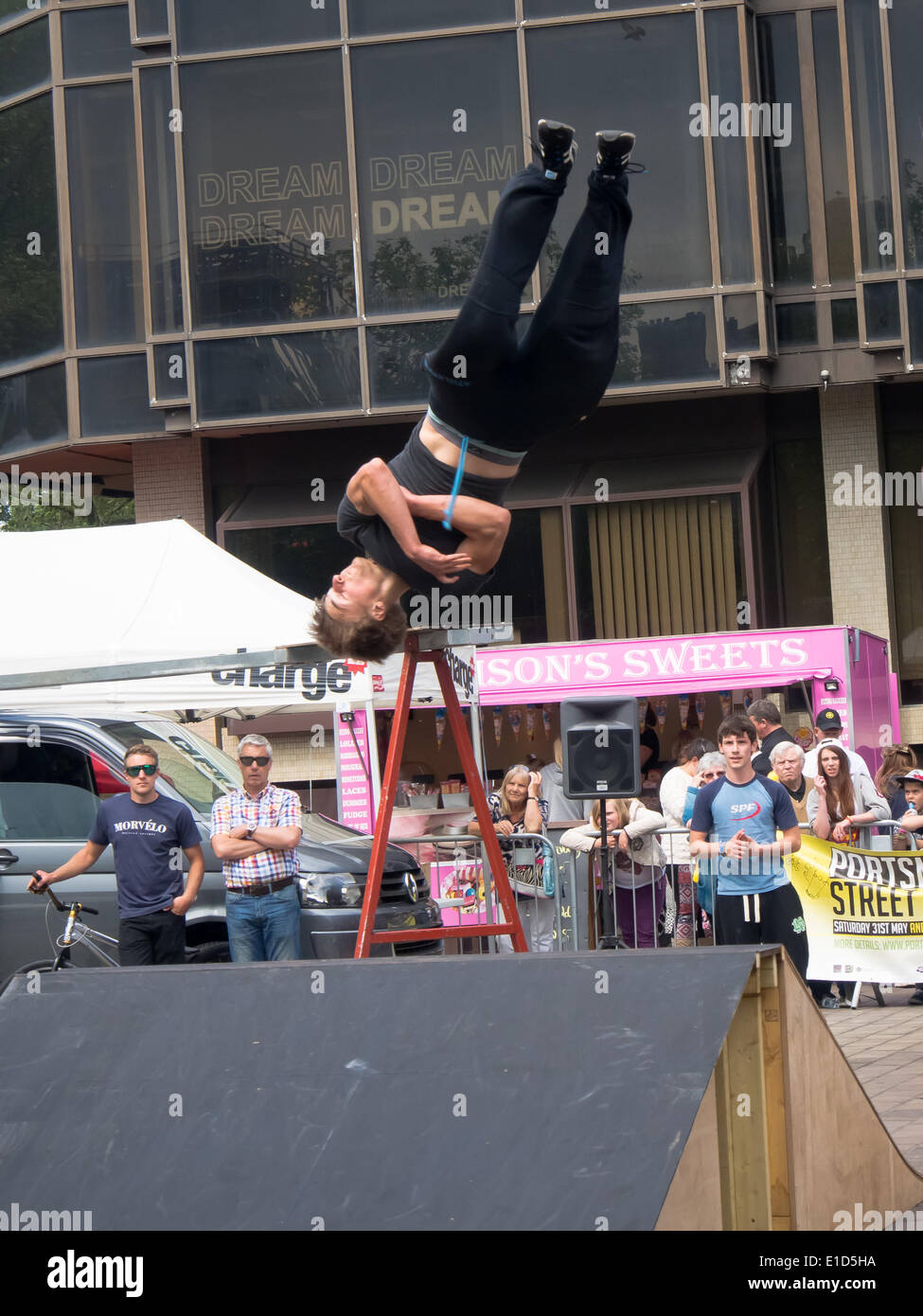 A free runner performs a twisting straight Somersault during the Portsmouth street games 2014 funded by the Portsmouth cultural trust - Stock Image