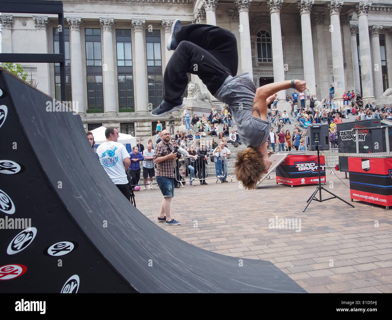 A street runner uses a quarter pipe to flip himself during the Portsmouth street games 2014 - Stock Image