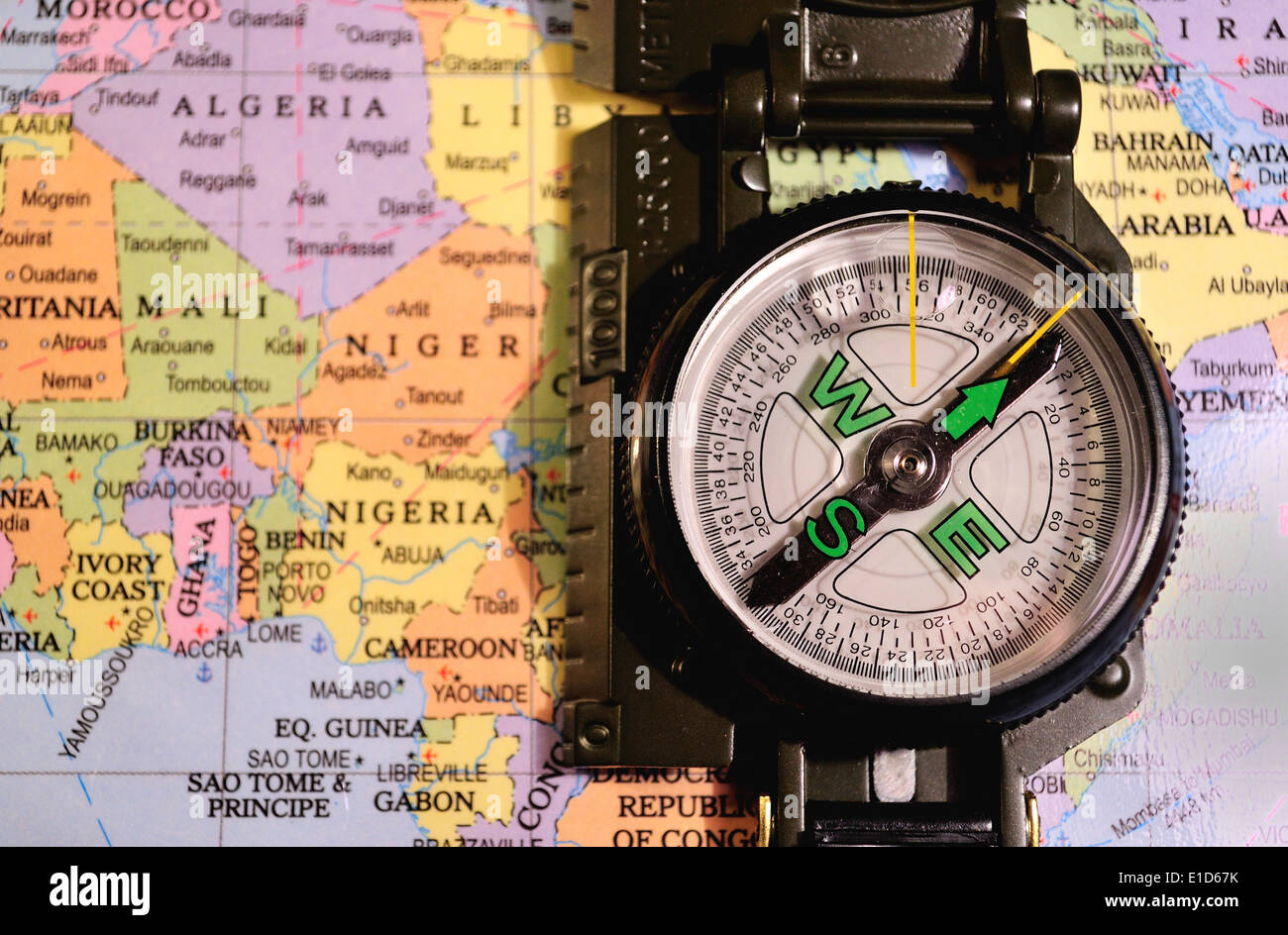 A magnetic compass on a map of Africa. - Stock Image