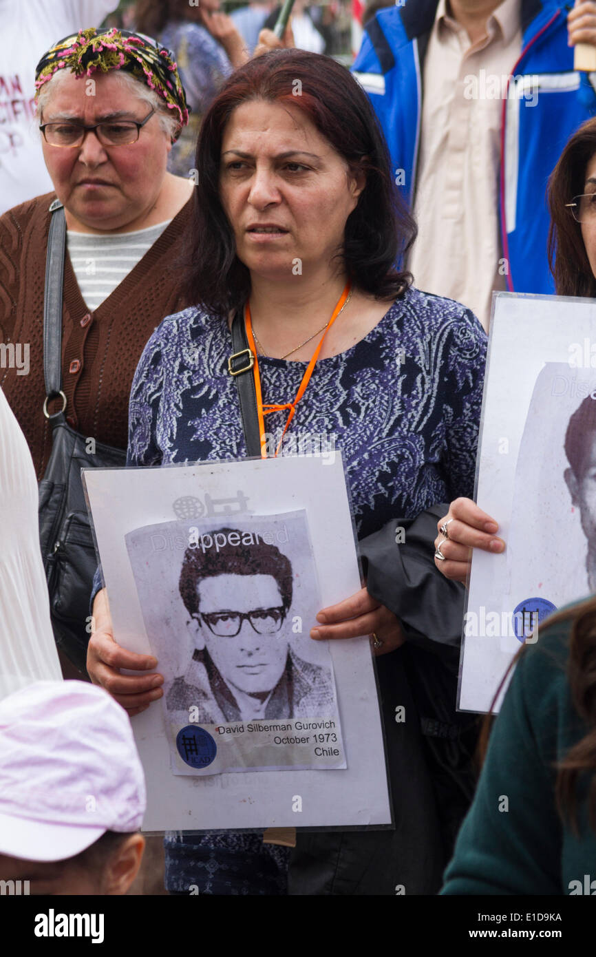 Woman holding photograph of one the disappeared victims from Chile in the 1970s participates in the International Committee Against Disappearances (ICAD) march, London 31st May 2014. - Stock Image