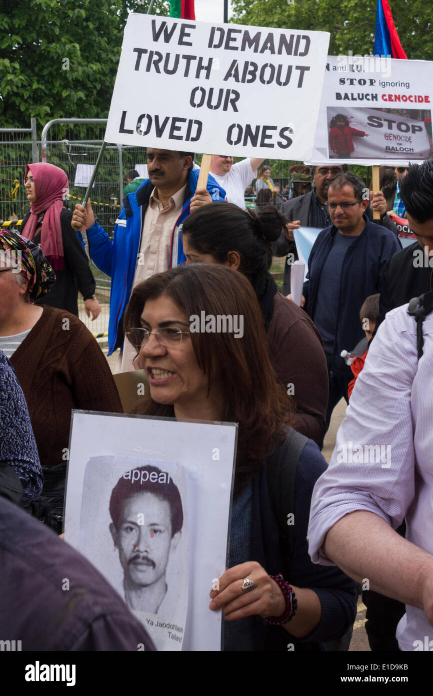 Protesters against political disappearances around the world participate in the International Committee Against Disappearances (ICAD) march, London 31st May 2014. - Stock Image