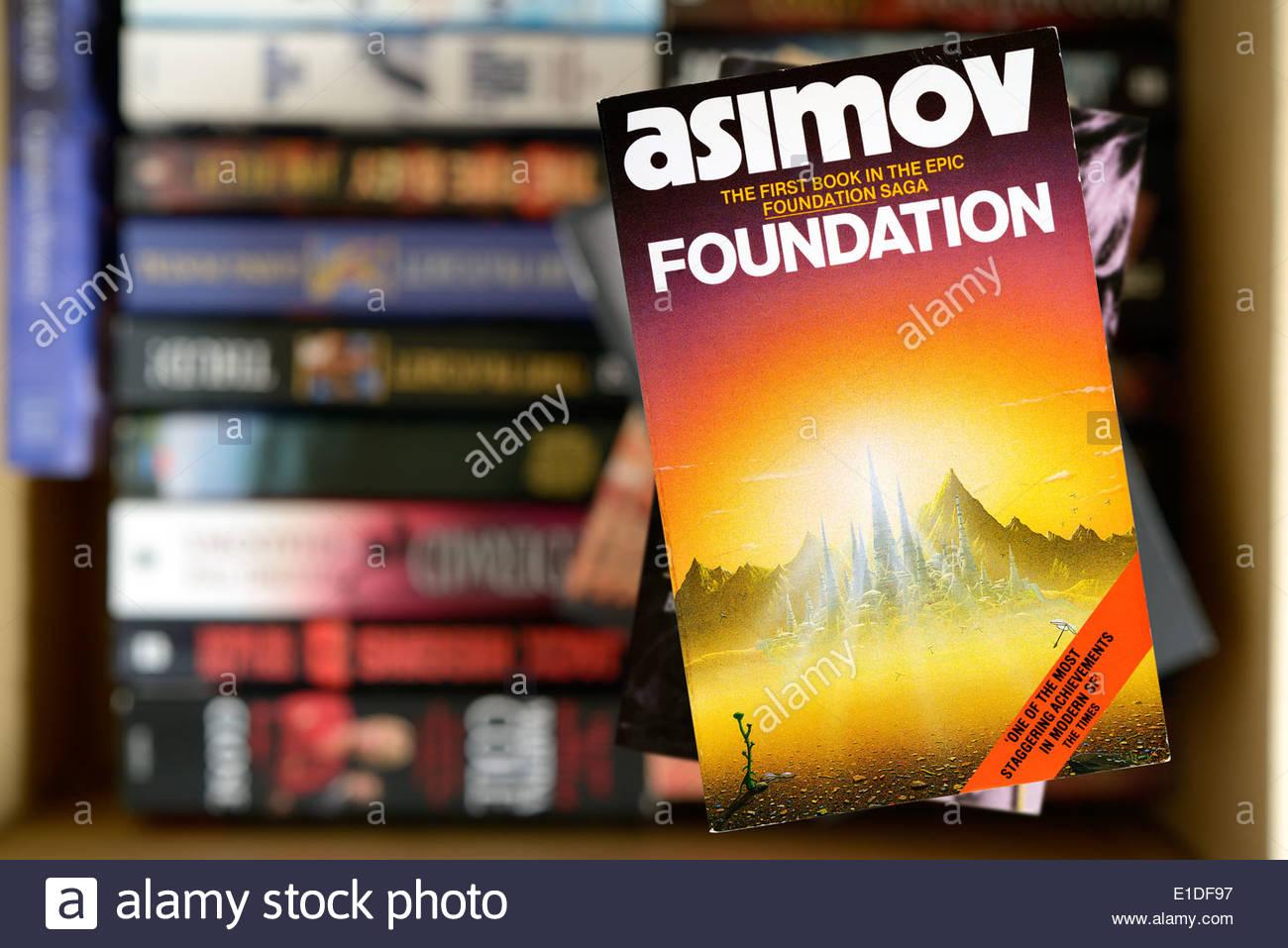 Isaac Asimov paperback title Foundation, stacked used books, England - Stock Image