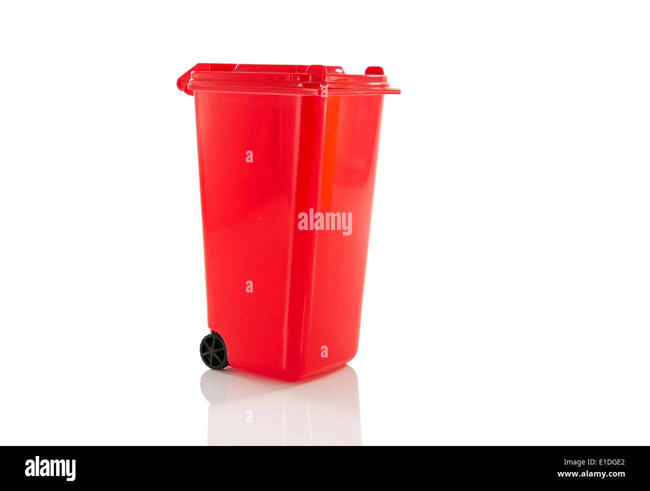 red garbage bin isolated on white - Stock Image