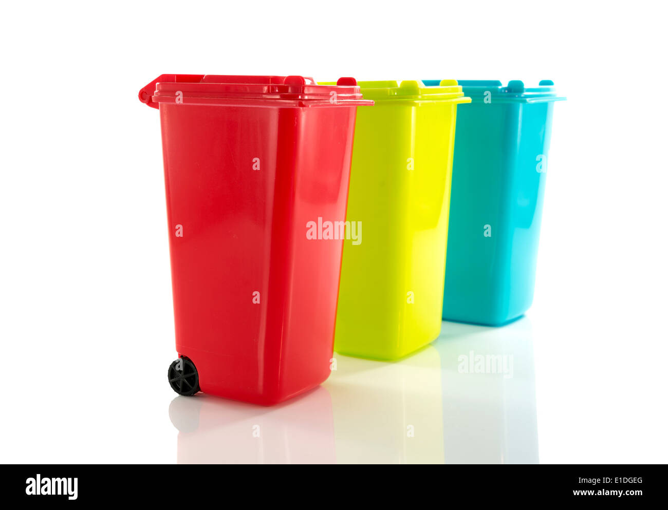 red blue and yellow green garbage bin isolated on white - Stock Image