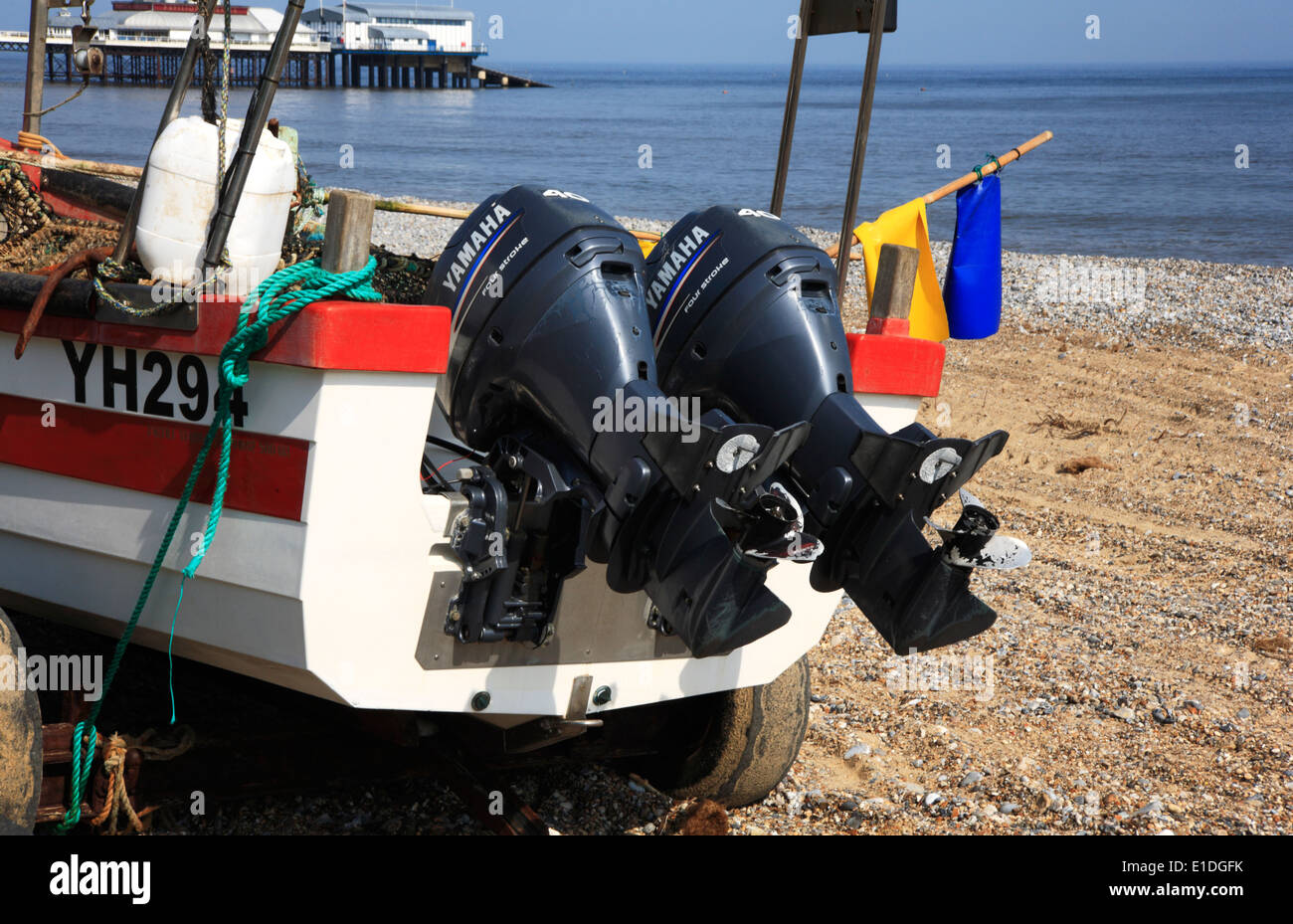 Twin outboard engines on an inshore fishing boat at Cromer, Norfolk, England, United Kingdom. - Stock Image