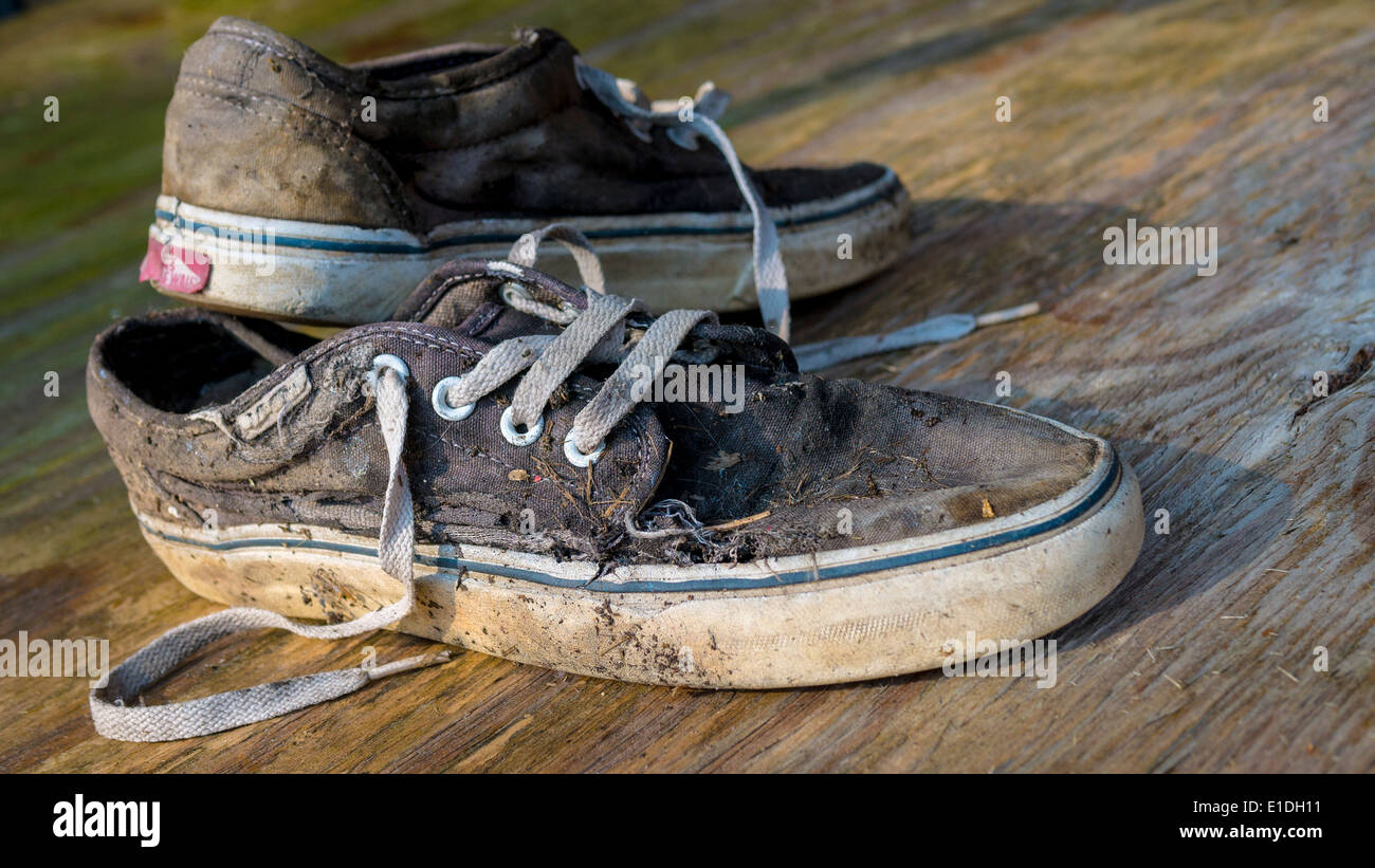 Pair of Worn Vans Trainers / Sneakers. - Stock Image