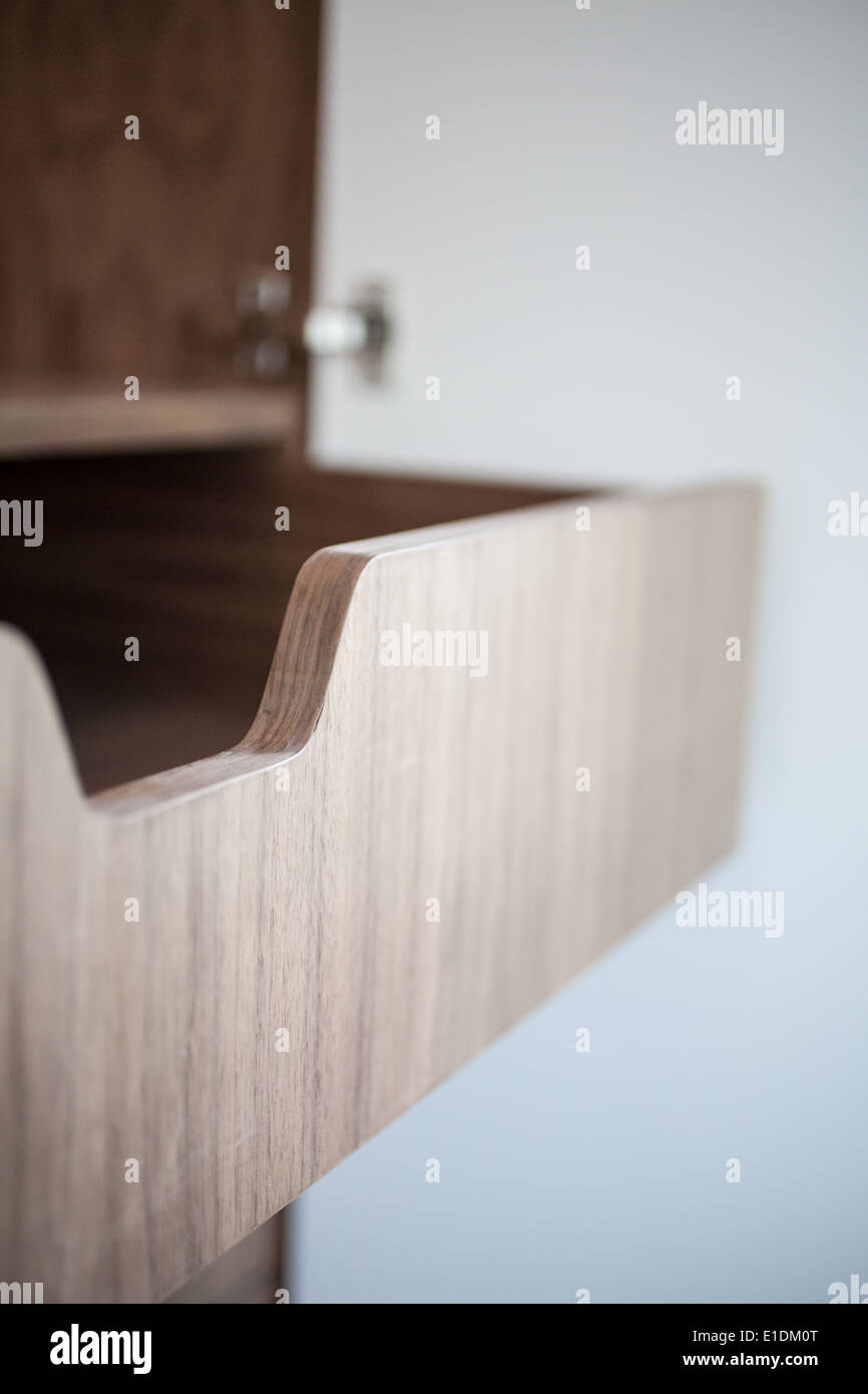 Open wooden drawers in close up - Stock Image