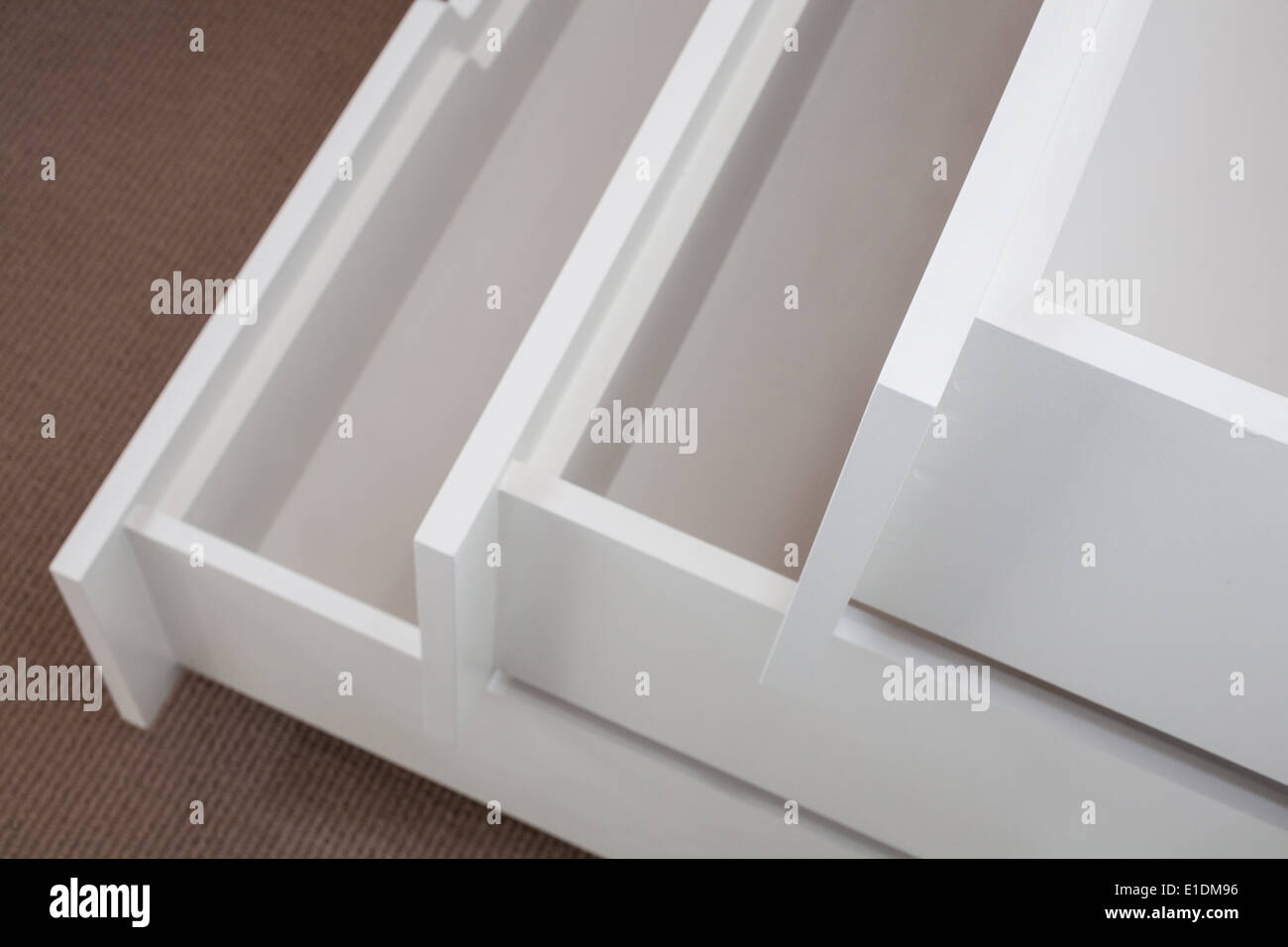 Open white drawers - Stock Image