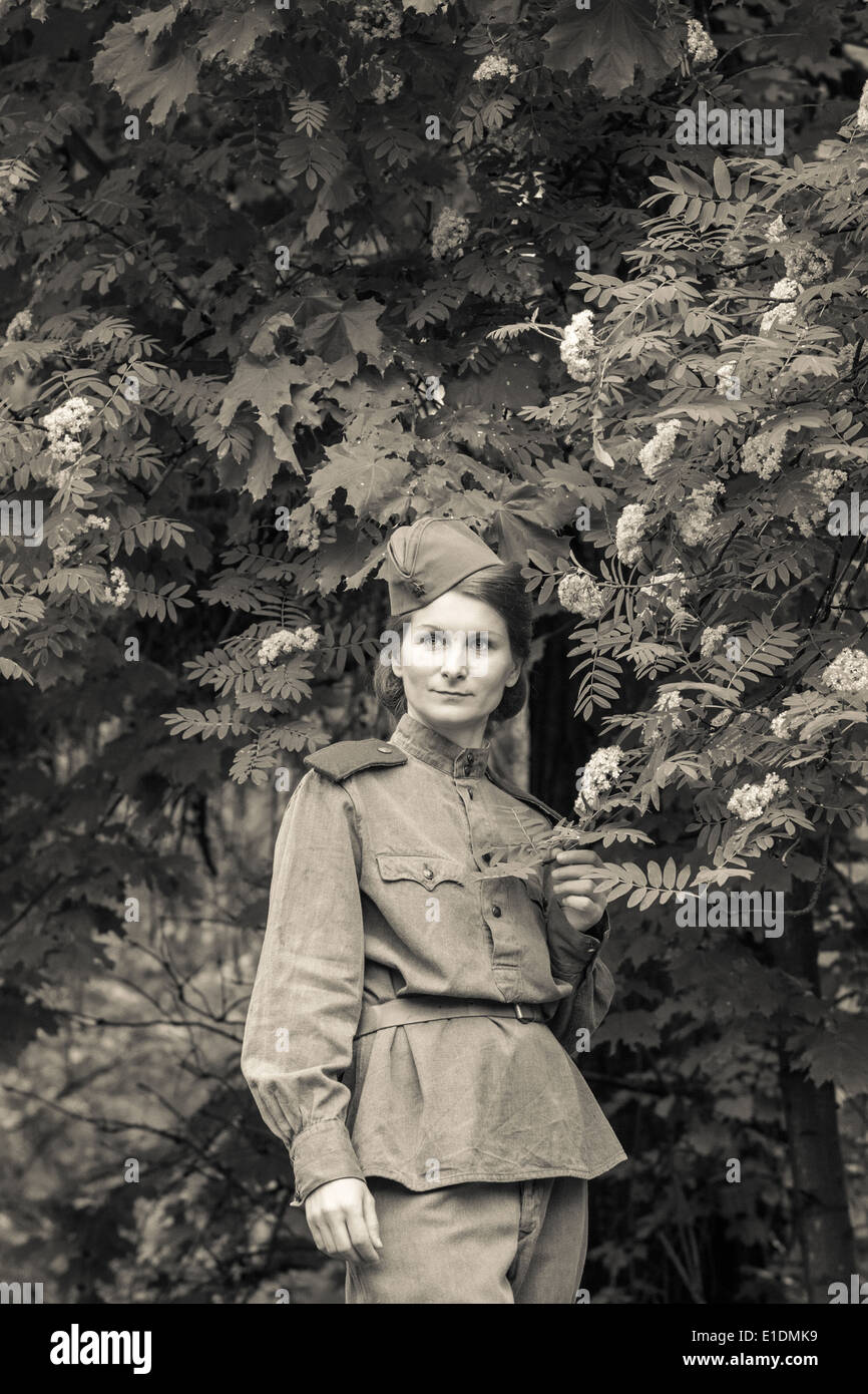 Young woman in Red Army form of 1943 year. Image with film grain effect. - Stock Image