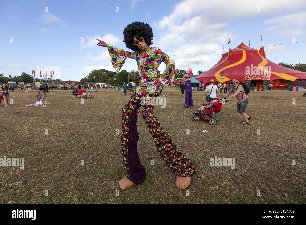 Man with a  70's  psychedelic dress in  Glastonbury Festival 2013 - Stock Image