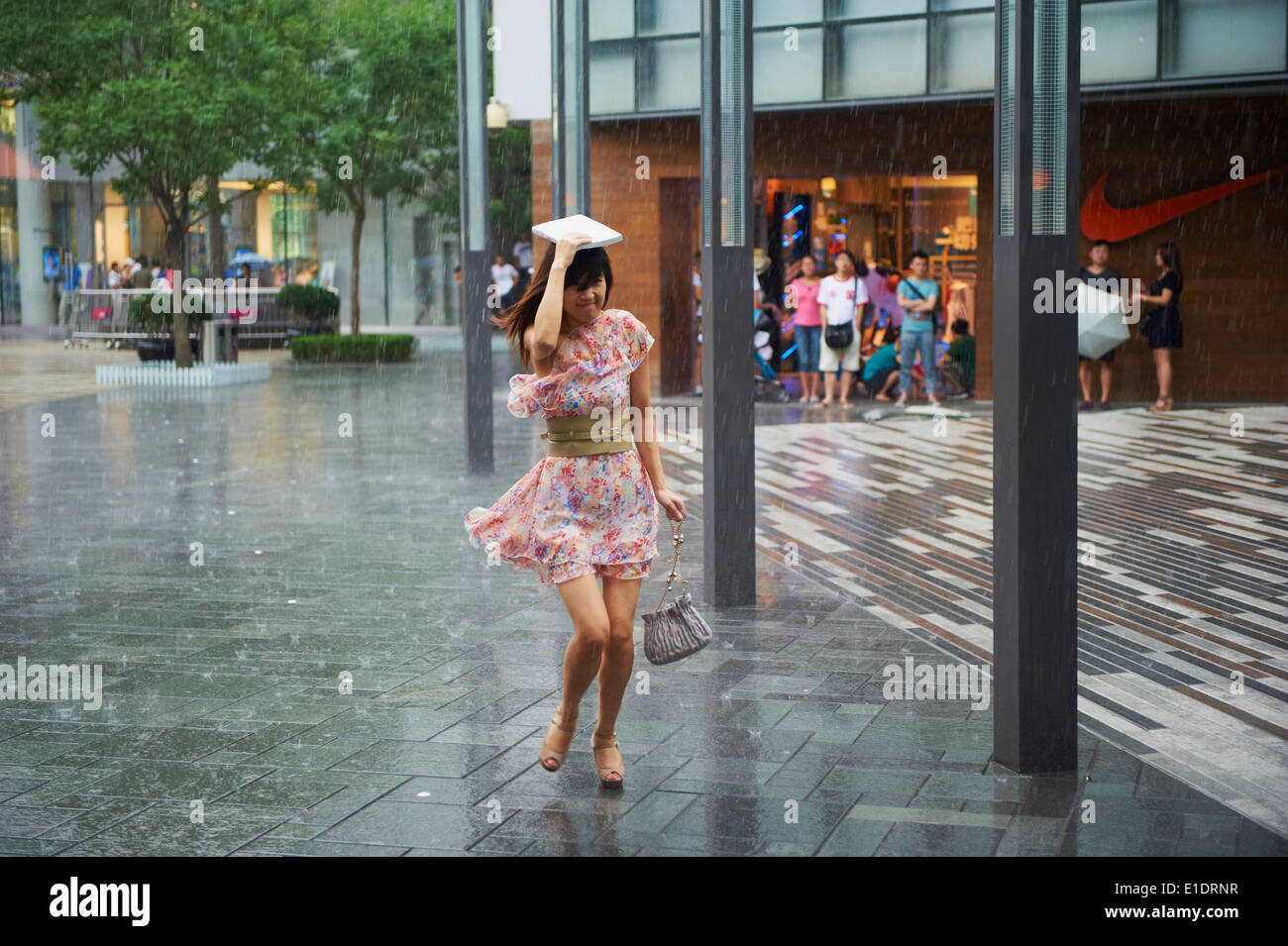 China, Beijing, Sanlitun area, raining day - Stock Image