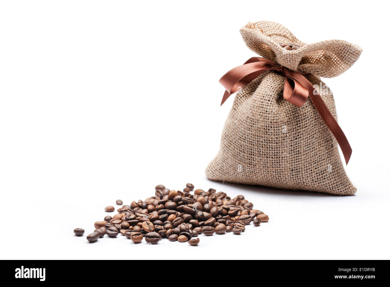 jute bag of coffee with coffee beans on white background - Stock Image