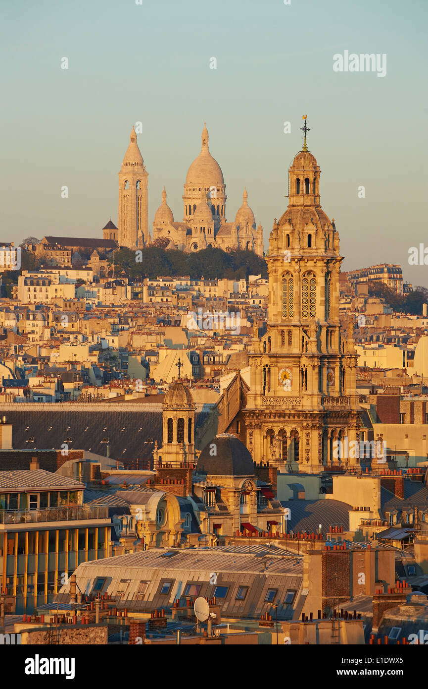 France, Paris, Sacre Coeur Basilique and Trinite church - Stock Image