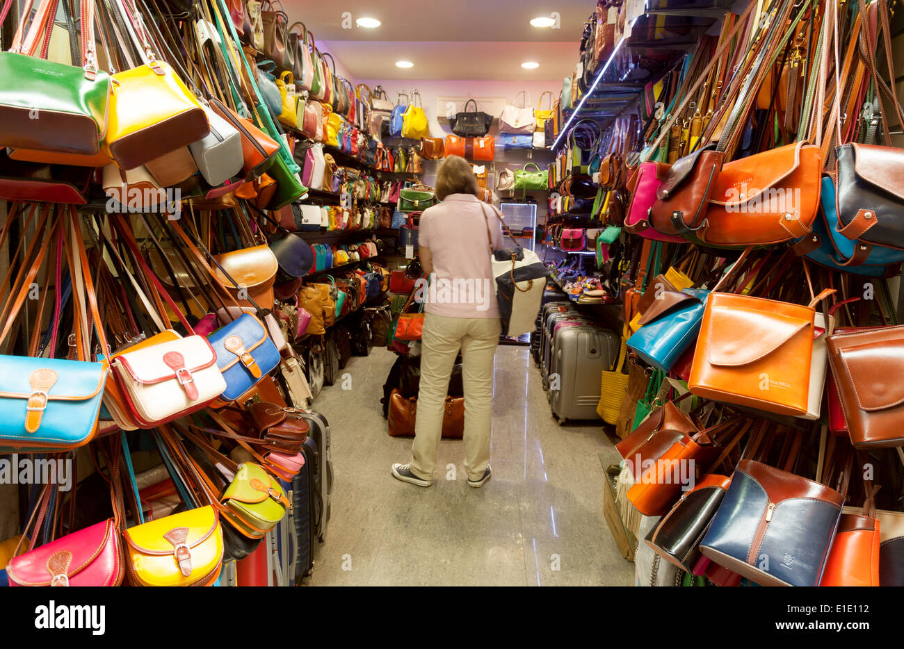 People shopping for handbags in a leather goods store shop, Rome Italy Europe - Stock Image