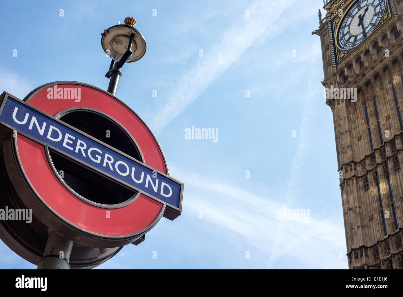 A London tube sign with Big Ben in the background, England, UK, - Stock Image