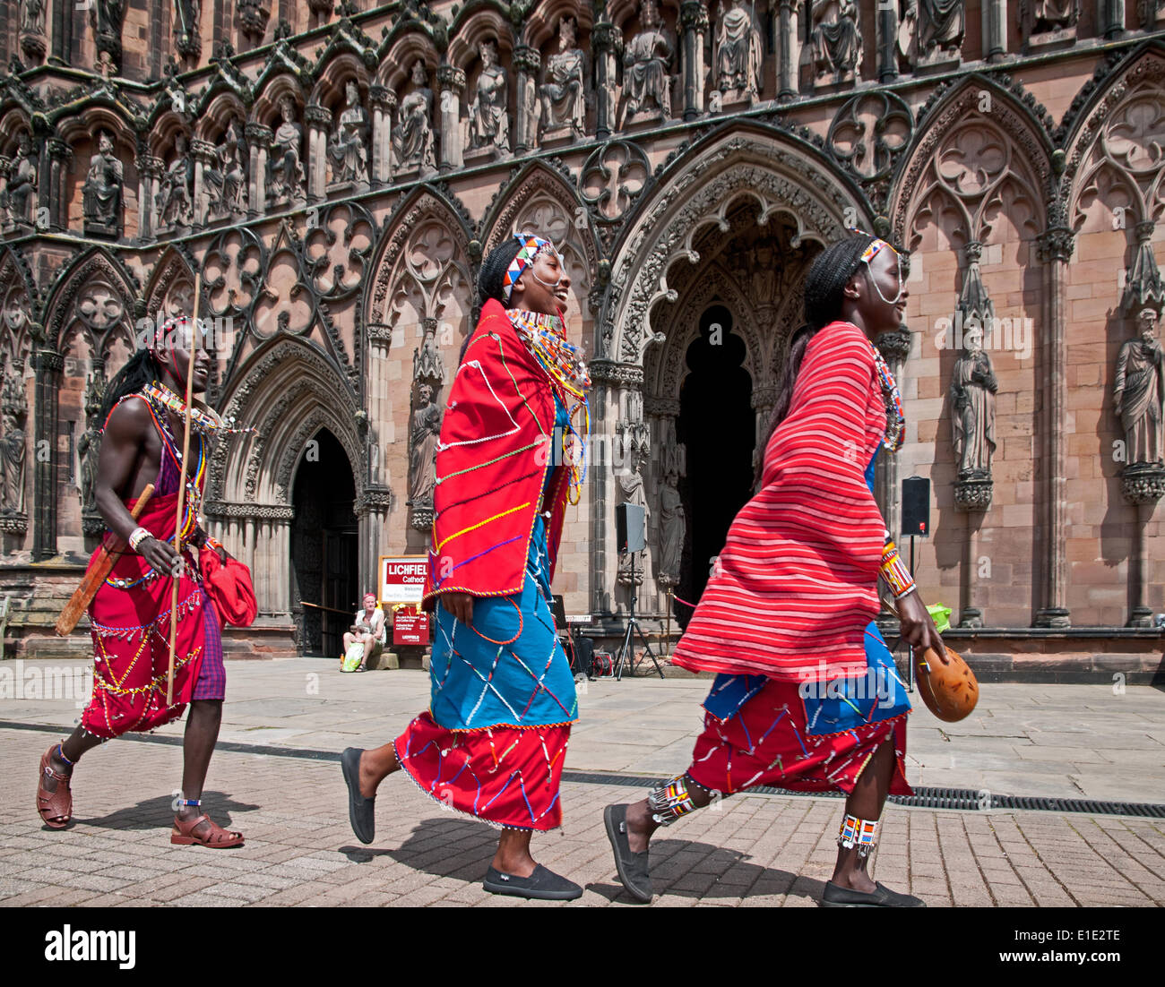 Lichfield, UK. 01st June, 2014. Maasai dancers entertaining people at Lichfield Cathedral Staffordshire England on Sunday 1st June 2014.  They visited Lichfield as part of a tour raising funds to benefit their villages back home in Kenya Credit:  David Keith Jones/Alamy Live News - Stock Image