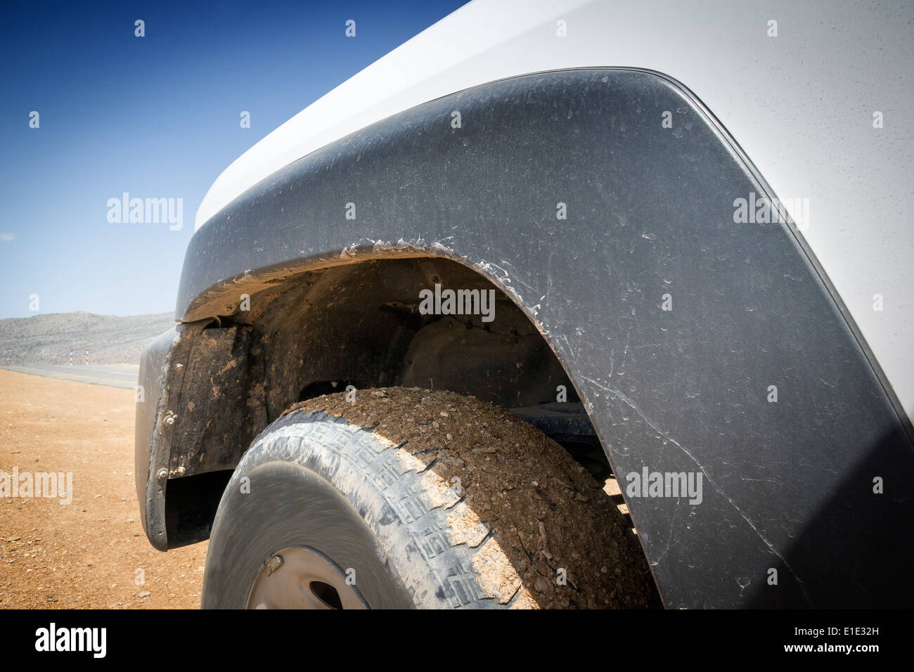 Closeup image of a offroad car in the desert of Oman - Stock Image