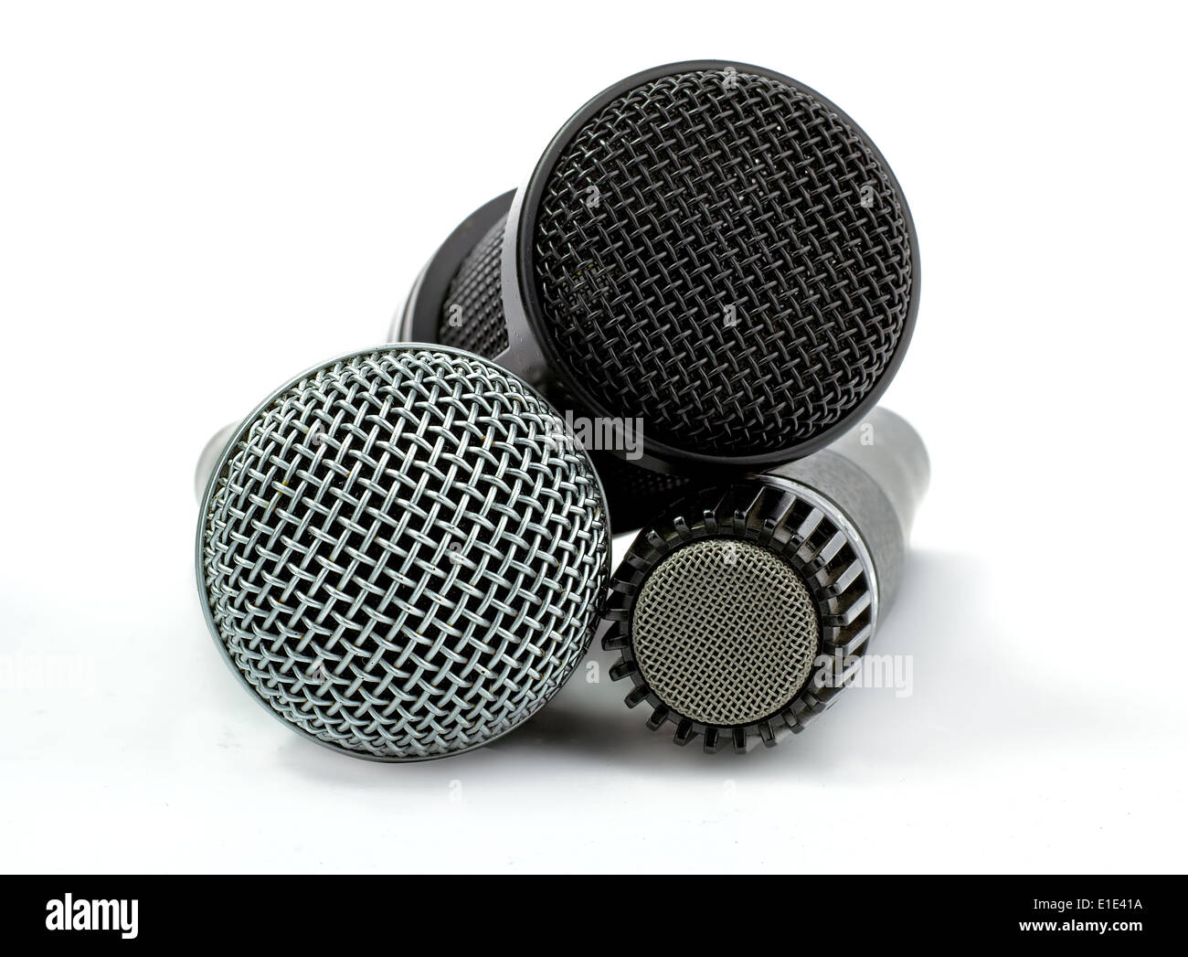 one condenser microphone and two dynamic microphones, isolated on white background - Stock Image
