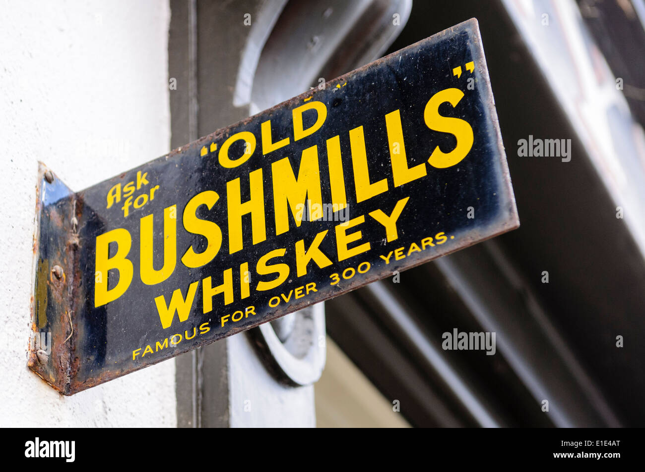 Sign for Old Bushmills Whiskey outside a pub - Stock Image