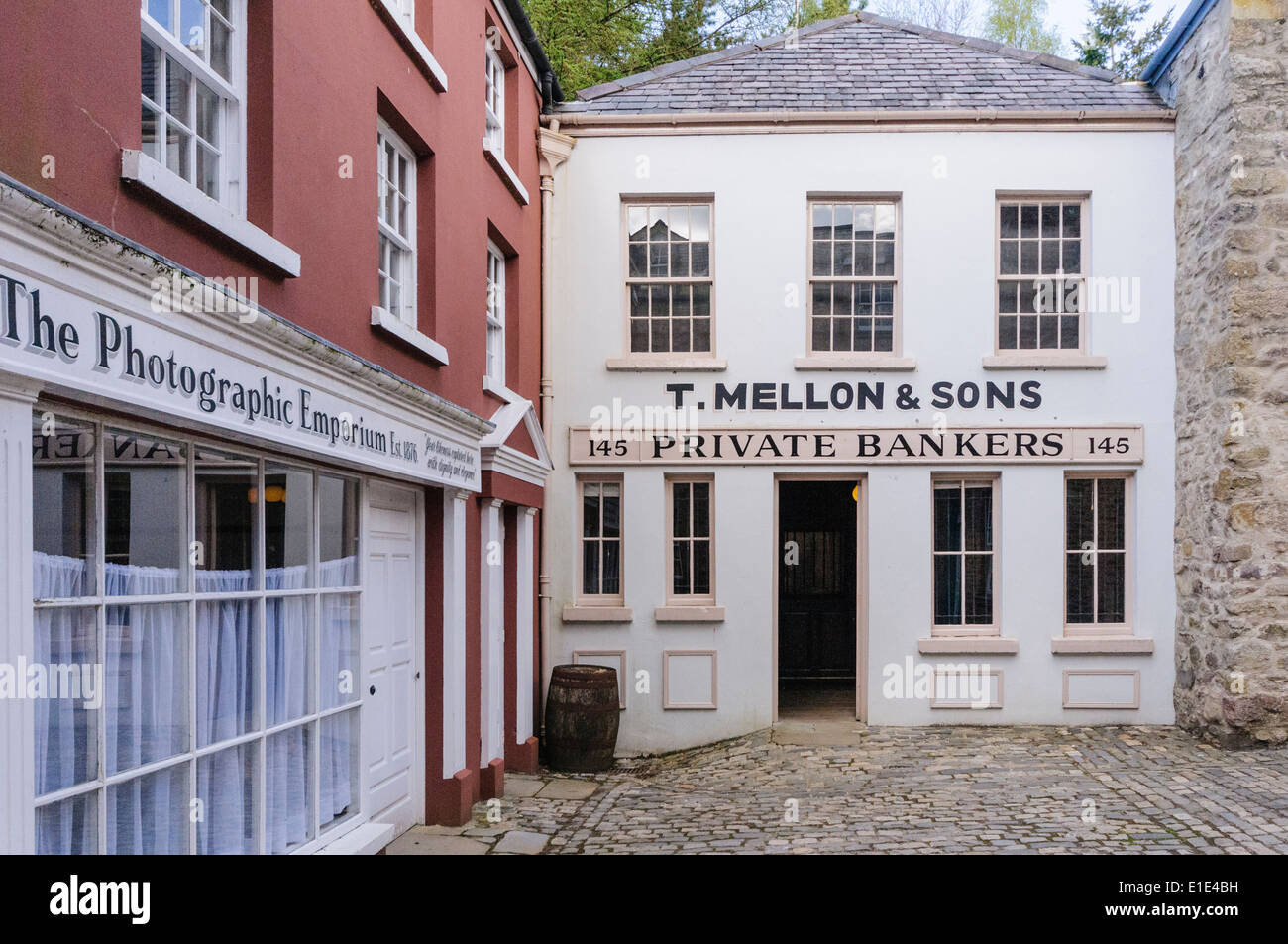 Photographic studio and bank on an old fashioned cobbled street. in the Ulster American Folk Park, Northern Ireland - Stock Image
