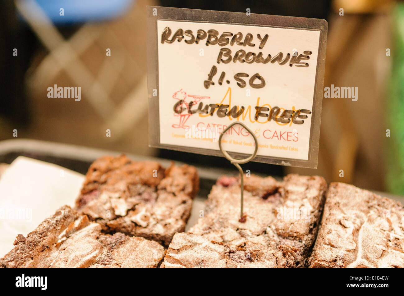 Gluten Free raspberry brownies on sale at a market stall - Stock Image
