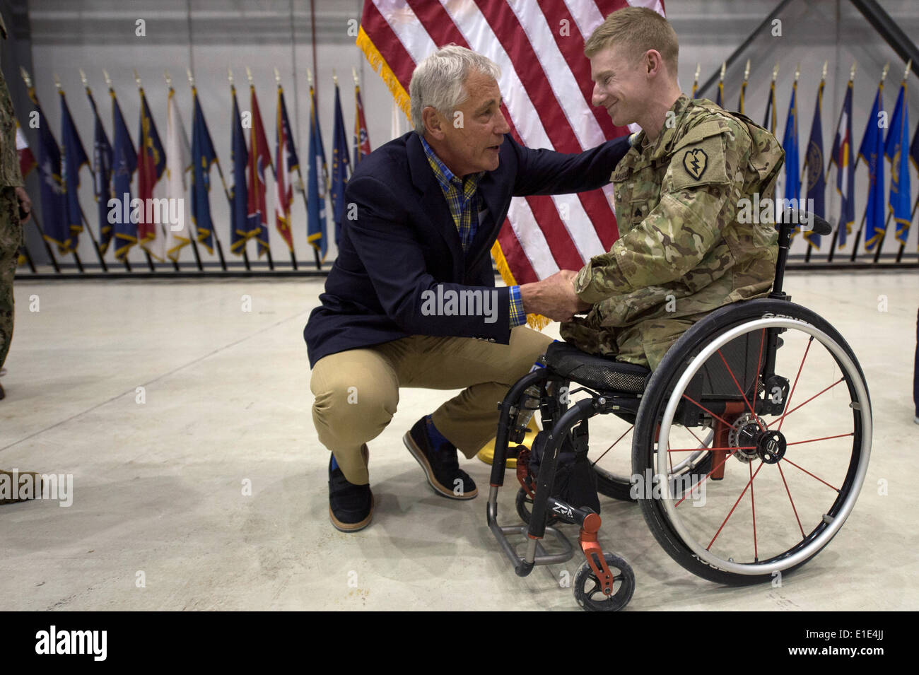 US Secretary of Defense Chuck Hagel speaks to a wounded warrior June 1, 2014 during a surprise visit to Bagram Airfield, Afghanistan. - Stock Image
