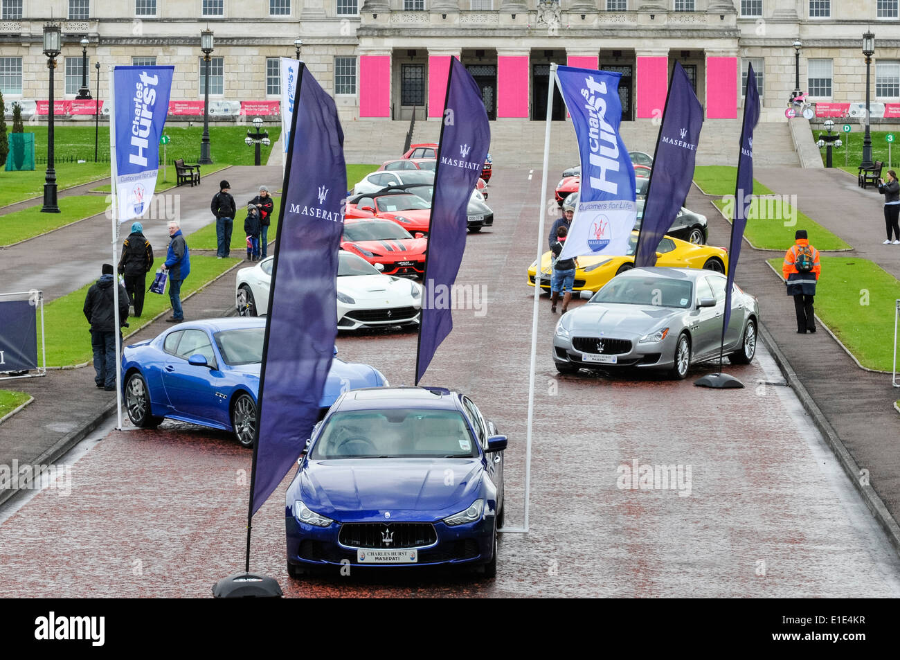 A number of Maserati and Ferrari cars on display - Stock Image