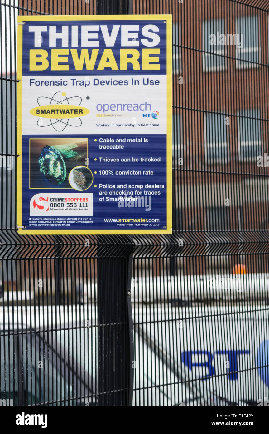 Sign at a BT depot advising thieves that Smartwater is in use to prevent cable theft - Stock Image