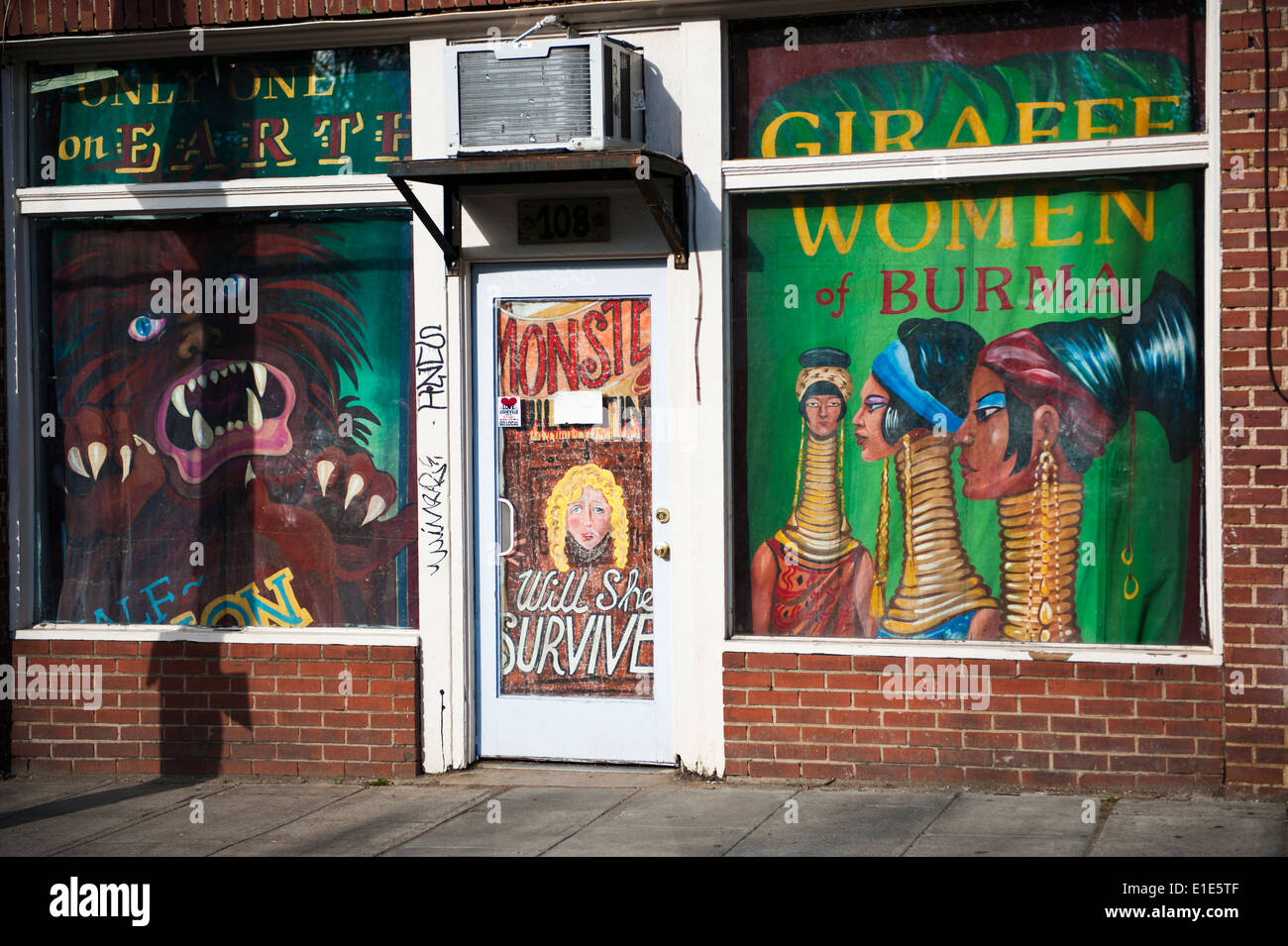 Store front with old 'freak show' posters in windows, Asheville North Carolina - Stock Image