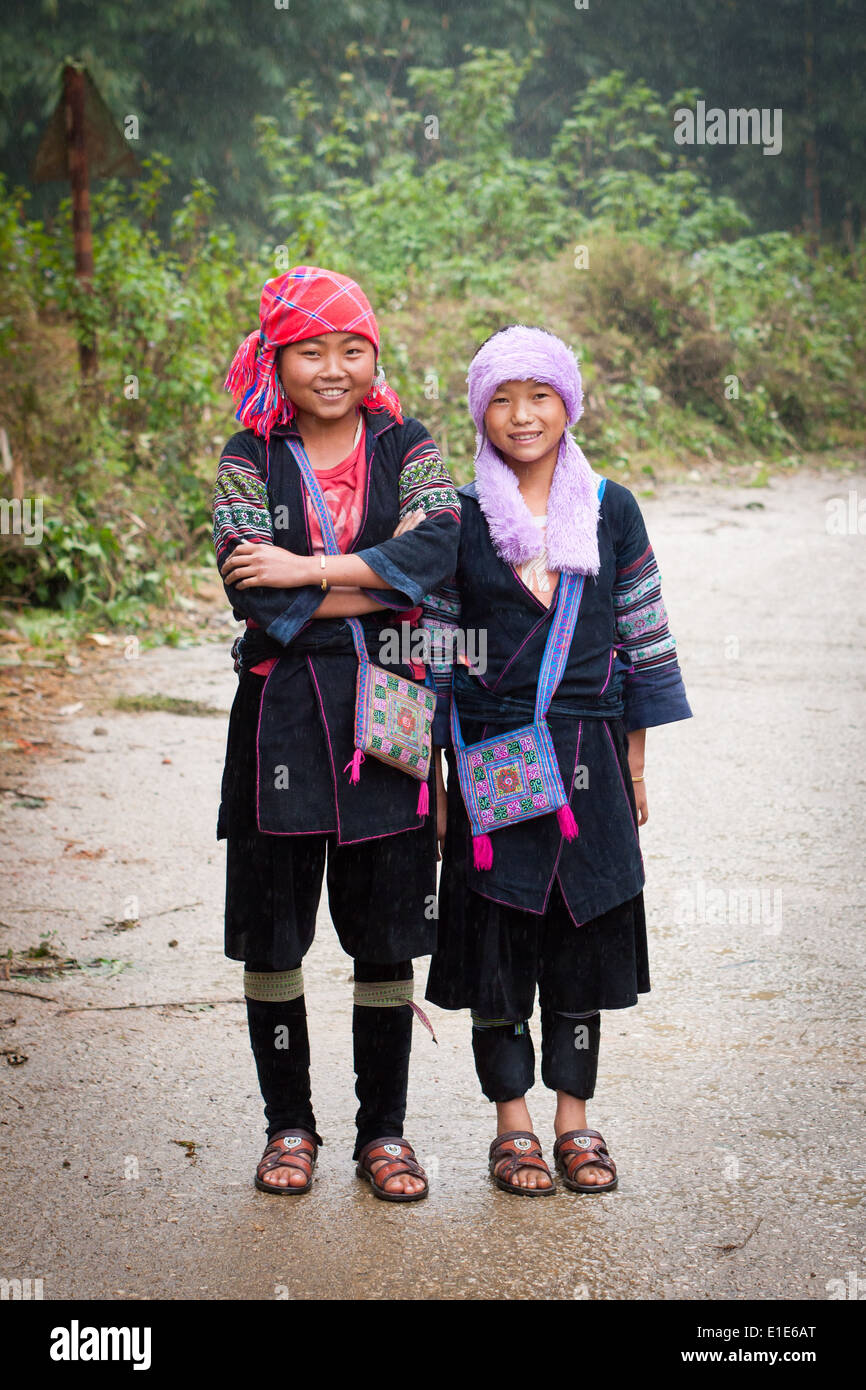 A couple of Black Hmong girls in traditional clothing, just outside of Sapa, Lao Cai Province, Vietnam. - Stock Image