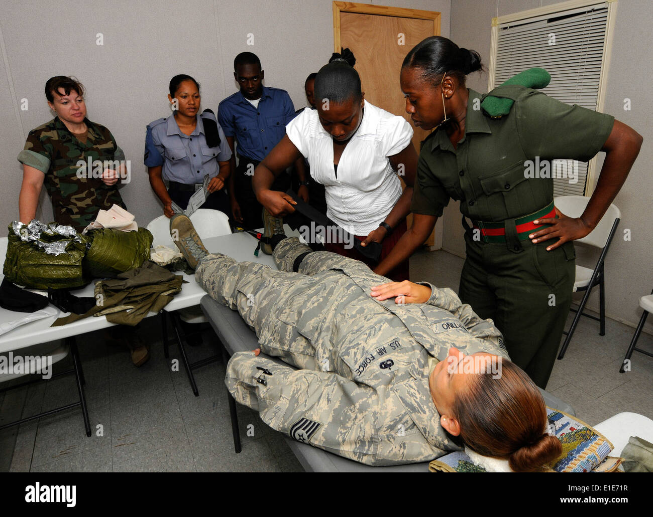 U.S. Navy Chief Hospital Corpsman Tracie Ham, with Maritime Civil Affairs and Security Training, observes as members Stock Photo