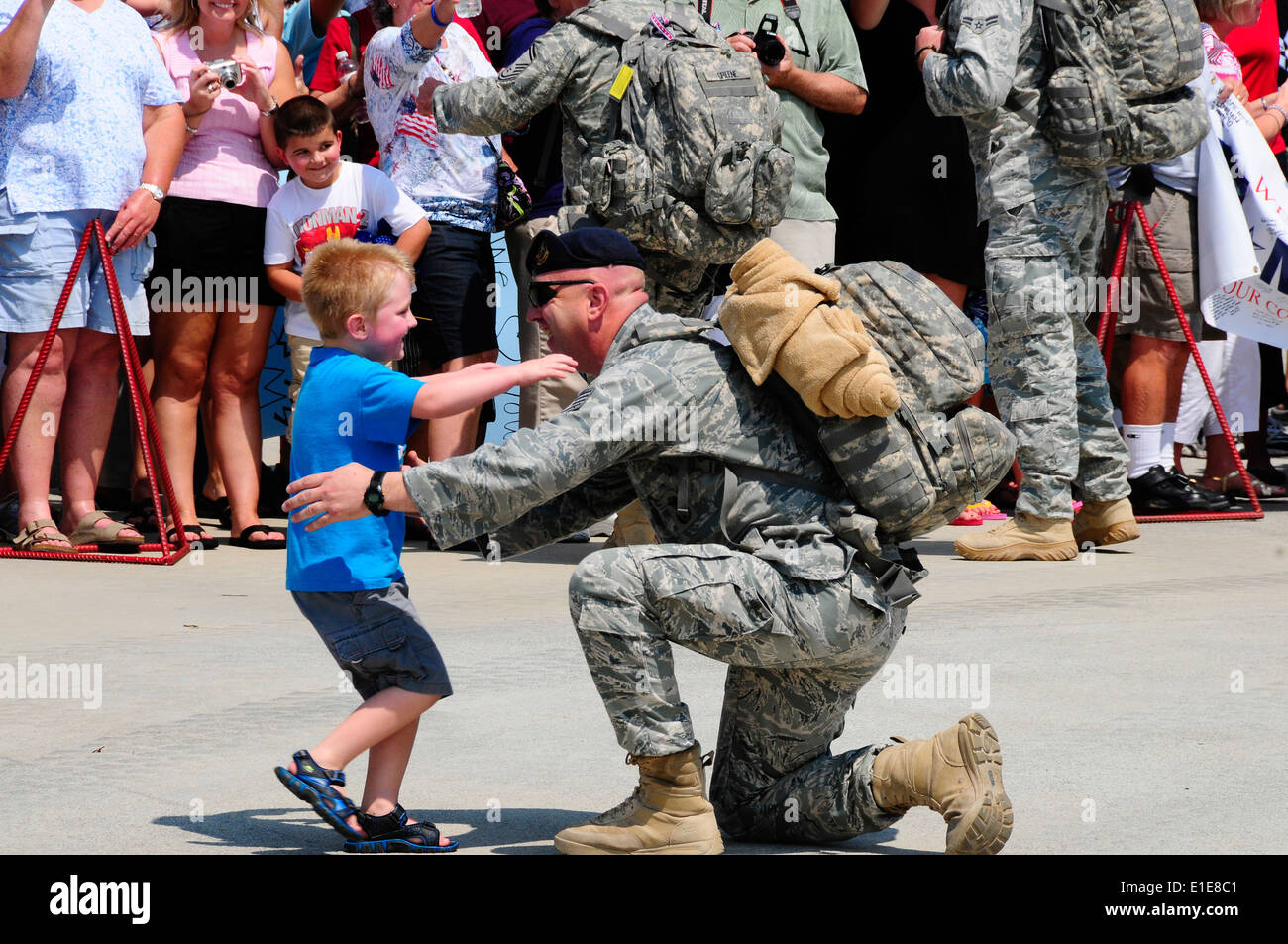 Tech. Sgt. Russell Buckner, 134 ARW Security Forces Squadron, recieves a well-earned hug from a family member after returning f - Stock Image