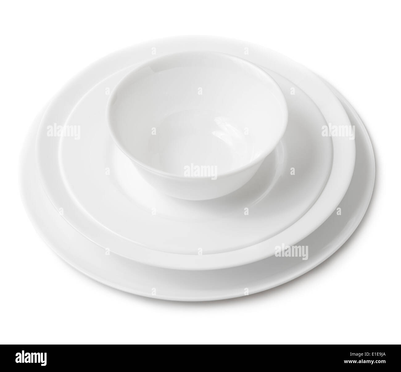 Pile of clean white plates and bowl. Isolated on white background. - Stock Image