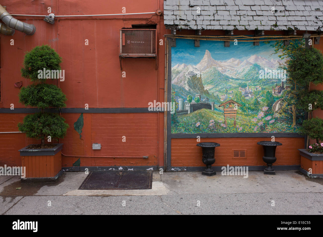 German fantasy landscape, painted on the side of a German bakery in New York City. - Stock Image