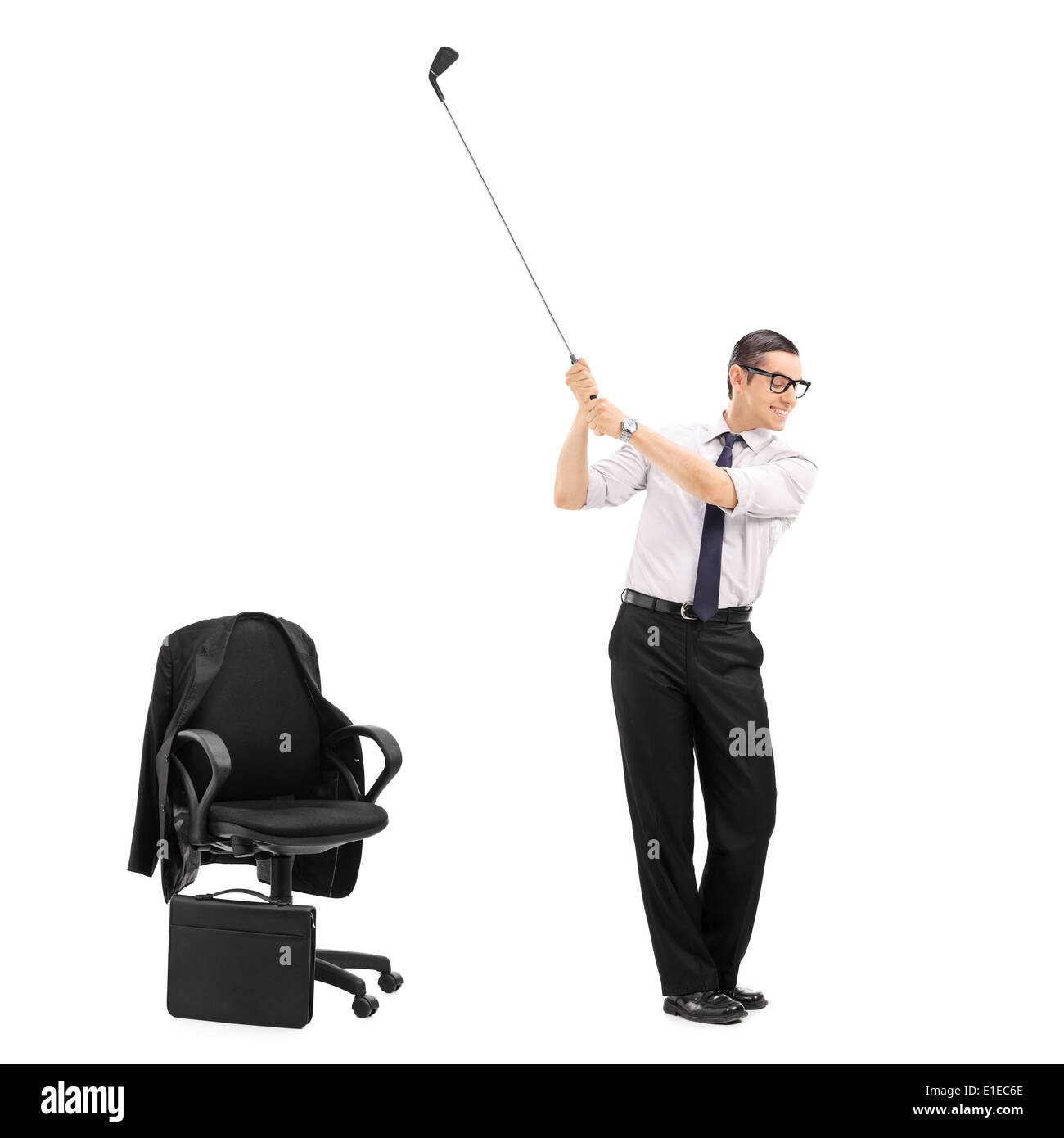 Businessman swinging a golf club with an office chair beside him  sc 1 st  Alamy & Businessman swinging a golf club with an office chair beside him ...