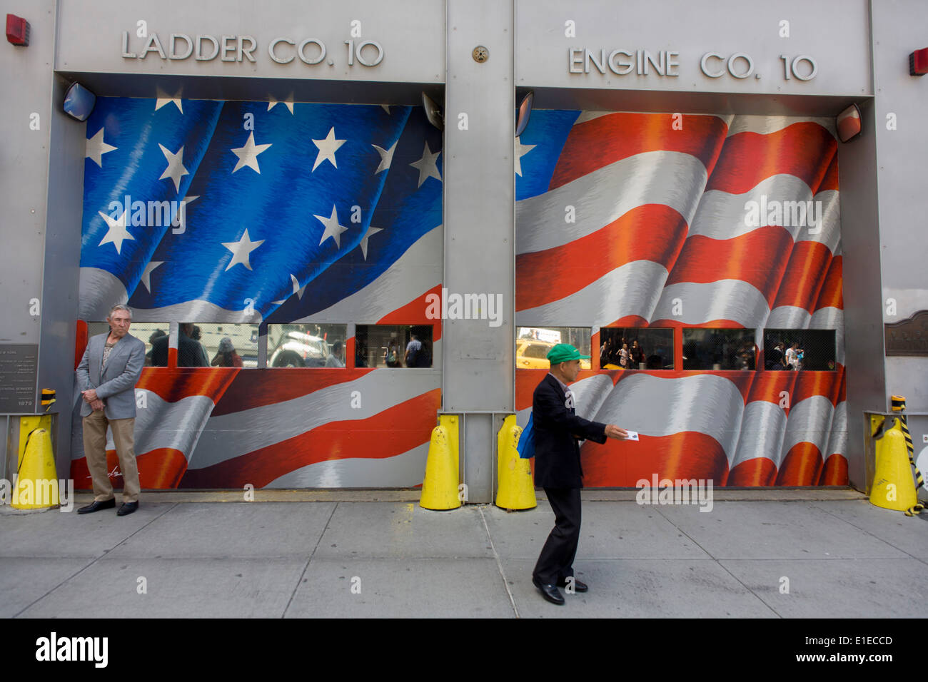 In front of a fire station, visitors use smartphones to record the new One World Trade Center opposite the 9/11 Stock Photo