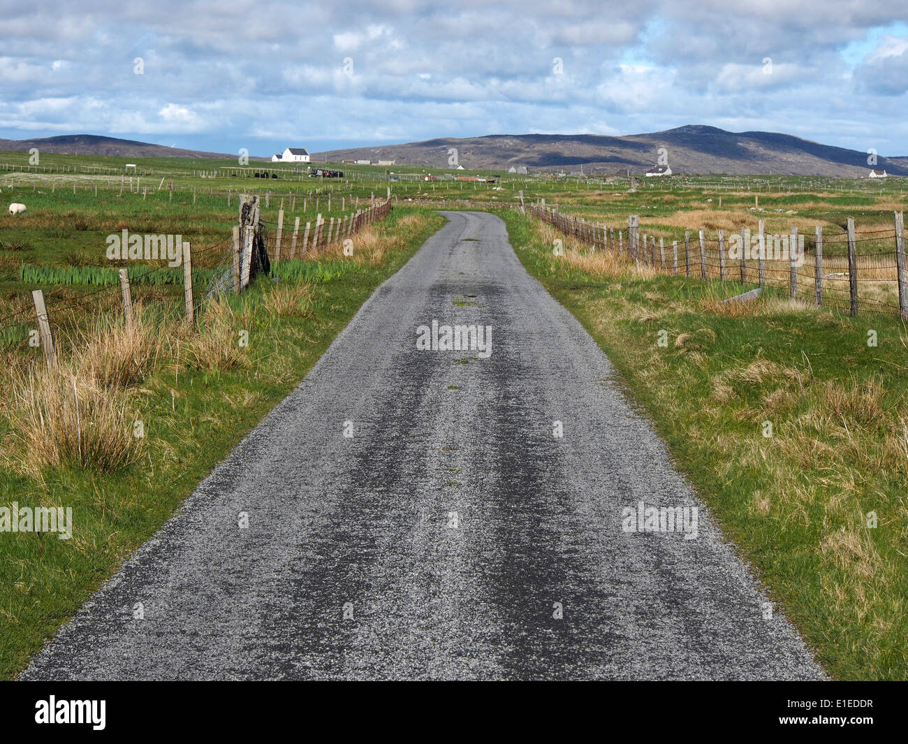 road on west coast of South Uist, Outer Hebrides, Scotland - Stock Image