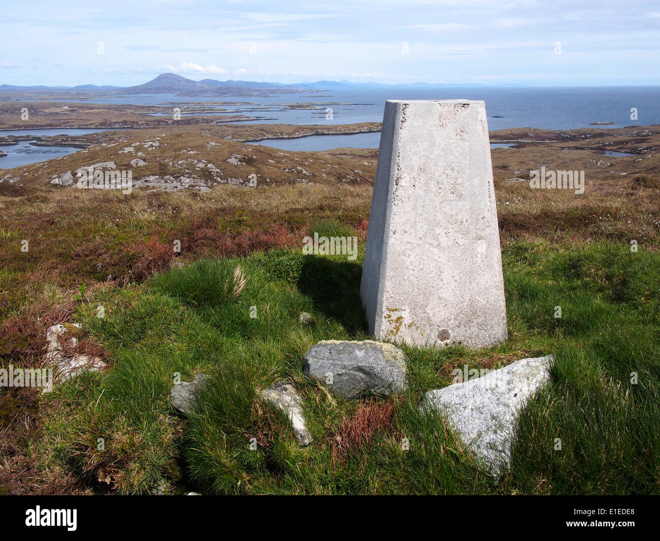 Trig point on summit of Beinn a Tuath (102m), Wiay (Fuidheigh), near Benbecula, Outer Hebrides, Scotland Stock Photo
