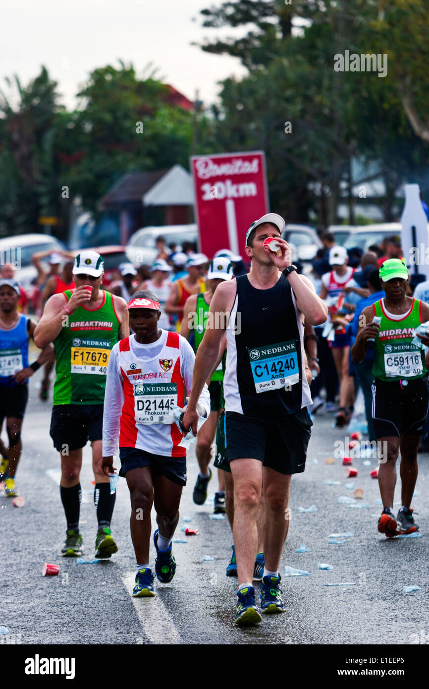 Runners Comrades marathon 2014 outside 45th Cutting Durban South Africa - Stock Image