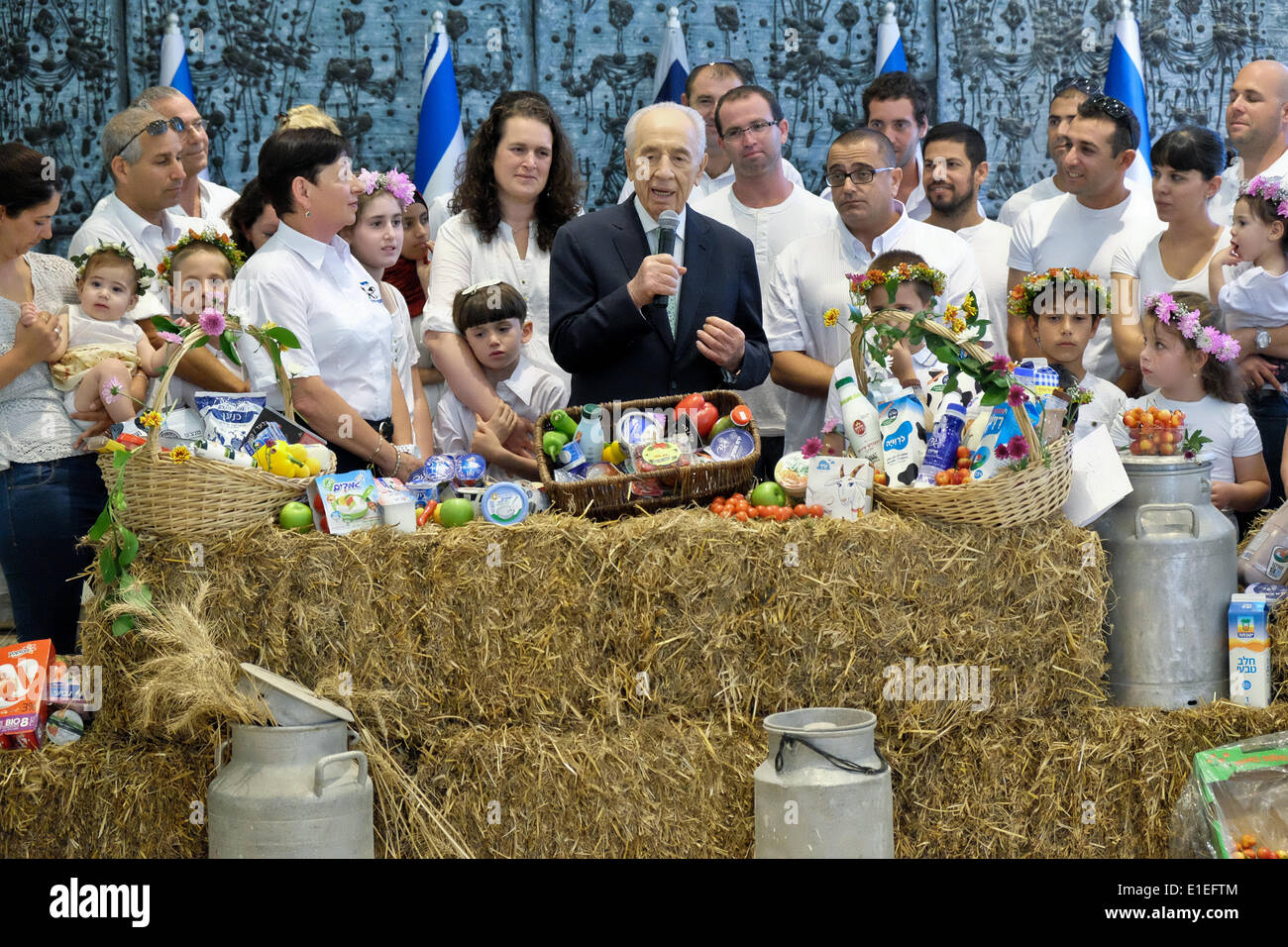 Israel, Jerusalem. 02nd June, 2014. Israeli President SHIMON PERES receives a basket with the best of Israel's dairy products from farmers from across the country. The President hosted a Bikkurim Festival for the Shavuot holiday, celebrating the giving of the Torah at Mt. Sinai. Also referred to as the Harvest Festival, in ancient times Jewish farmers brought their first fruits of the season to the Temple in Jerusalem as offerings. Credit:  Nir Alon/Alamy Live News - Stock Image
