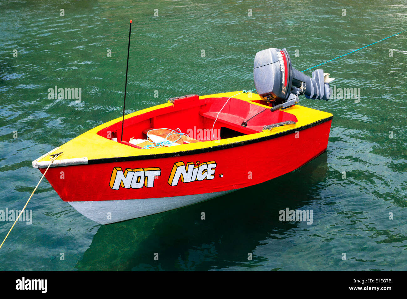 Small rowing boat with the name 'Not Nice' , in a harbour at St George, Grenada, West Indies - Stock Image