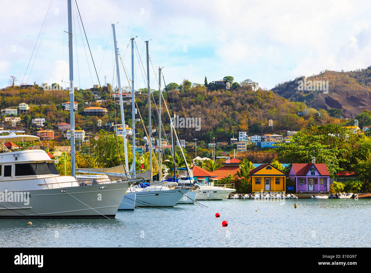 Yachts and houses in the Port Louis marina, in The Lagoon at St George's harbour, St George, Grenada, West Indies Stock Photo