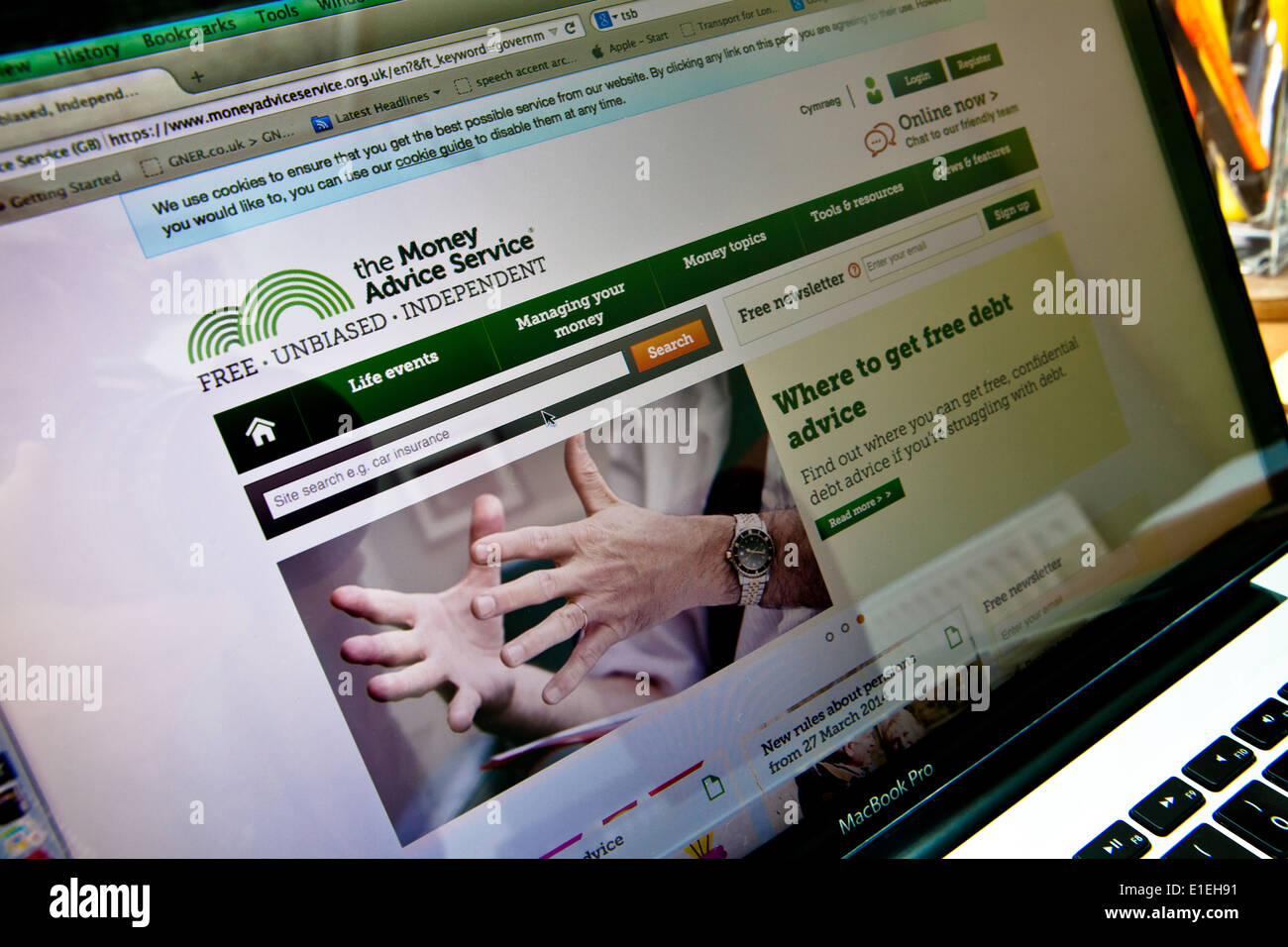 Computer laptop screen shown website for The Money Advice Service - Stock Image