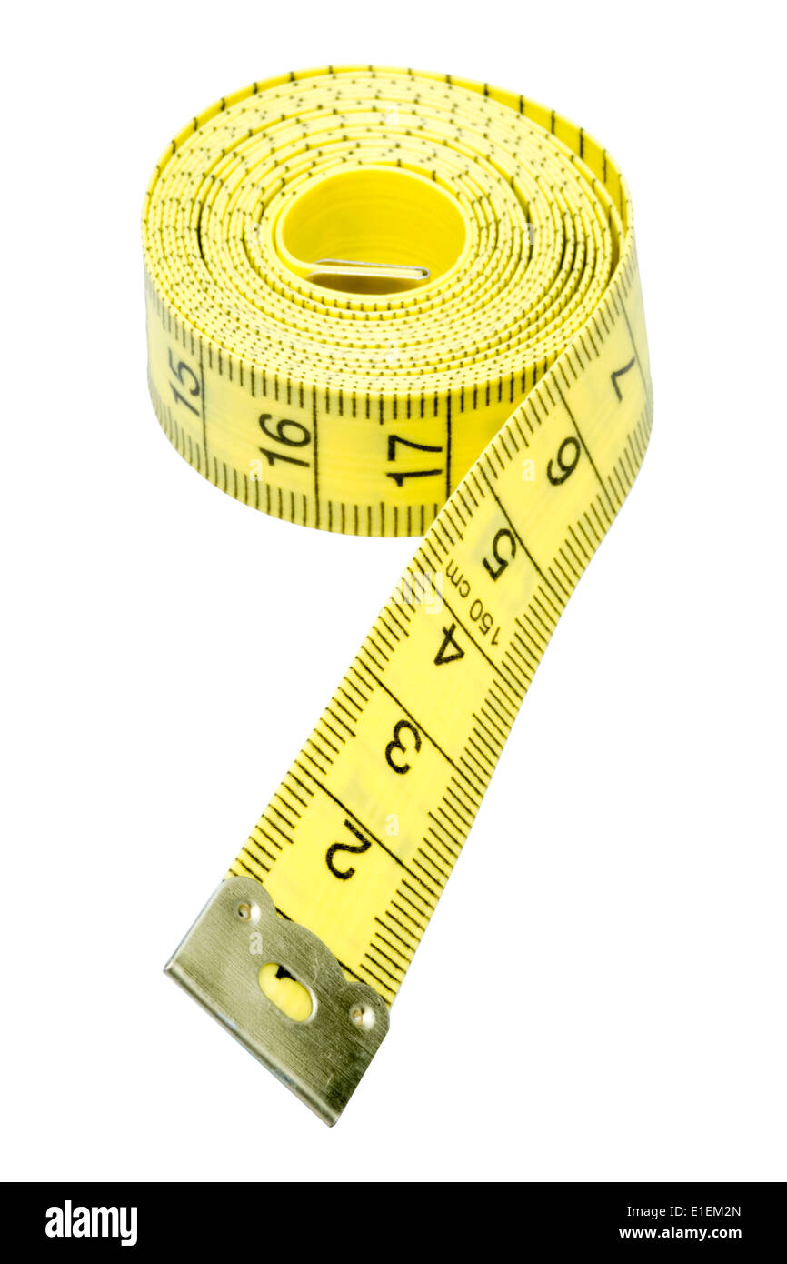 Tailors tape measure cut out against a white background. Yellow measuring tape. - Stock Image
