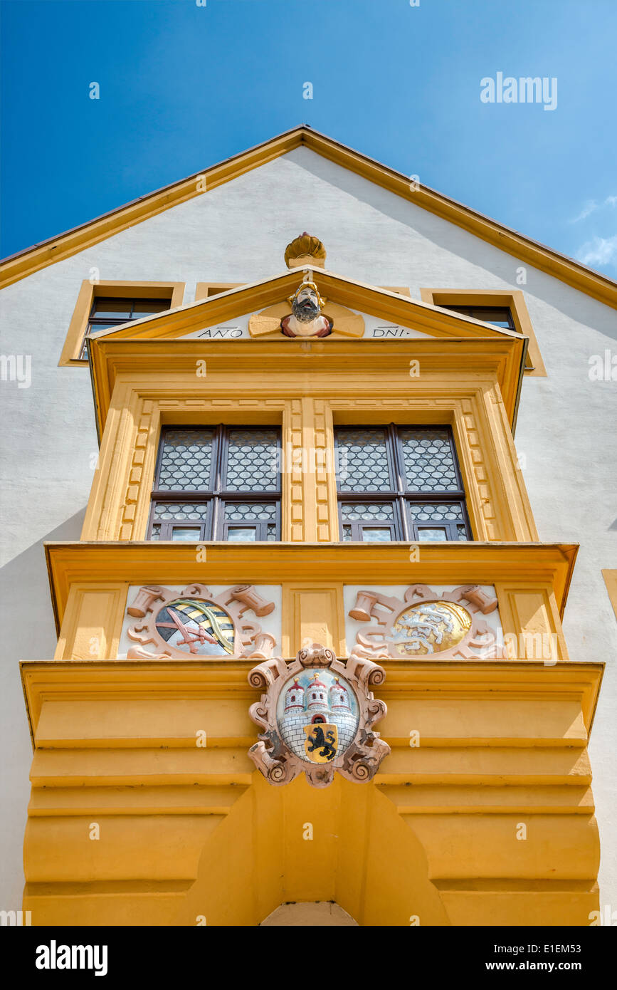 City's coat of arms, oriel window, at Rathaus (Town Hall) in Freiberg, Saxony, Germany - Stock Image