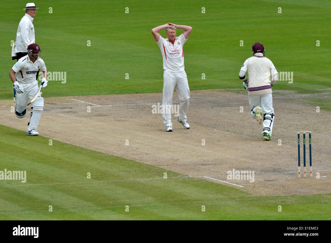 Emirates Old Trafford,  Manchester, UK. 2nd June 2014. Lancashire v Somerset.  Glen Chapple (Lancashire) bemoans his luck after seeing a lucky edge from the batsman go through the slips on the second day of the County Championship match. County  Championship Cricket Division 1  Manchester, UK Credit:  John Fryer/Alamy Live News - Stock Image