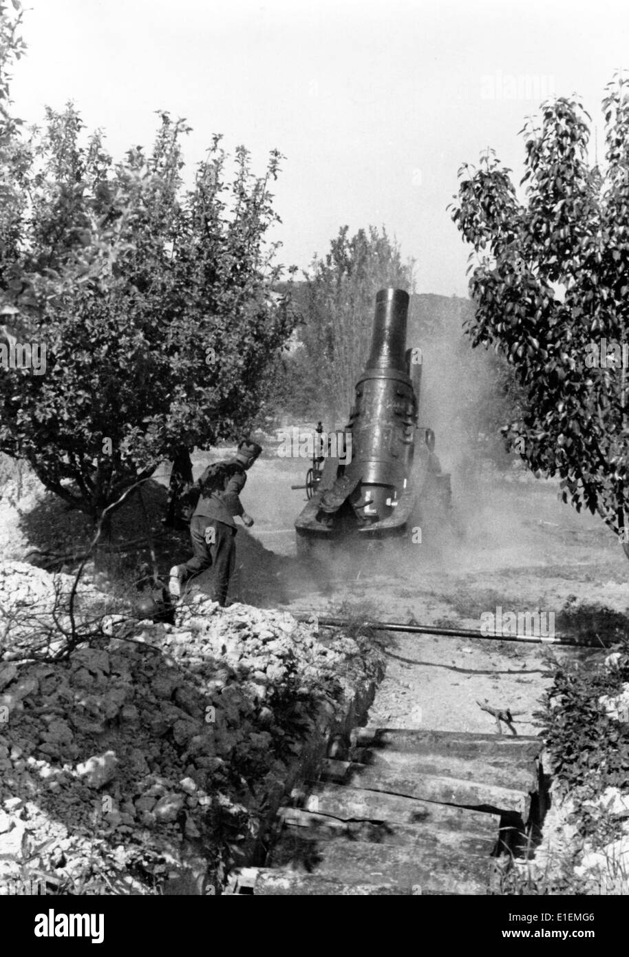 The picture from Nazi news reports shows a German soldier firing a canon near Sevastopol, in Crimea, 1942. Photo: Stock Photo