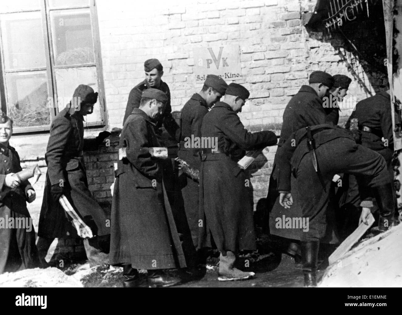 Soldiers queue in front of a front cinema at the Eastern Front, published 08 April 1942. Propaganda text! from Nazi Stock Photo